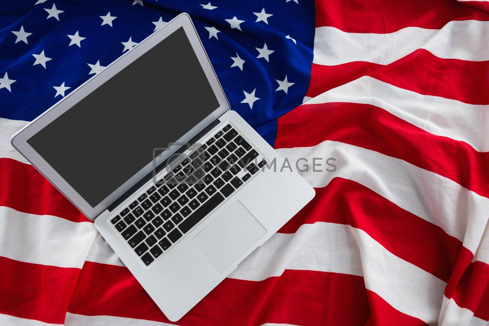 Close-up of laptop on American flag with 4th july theme