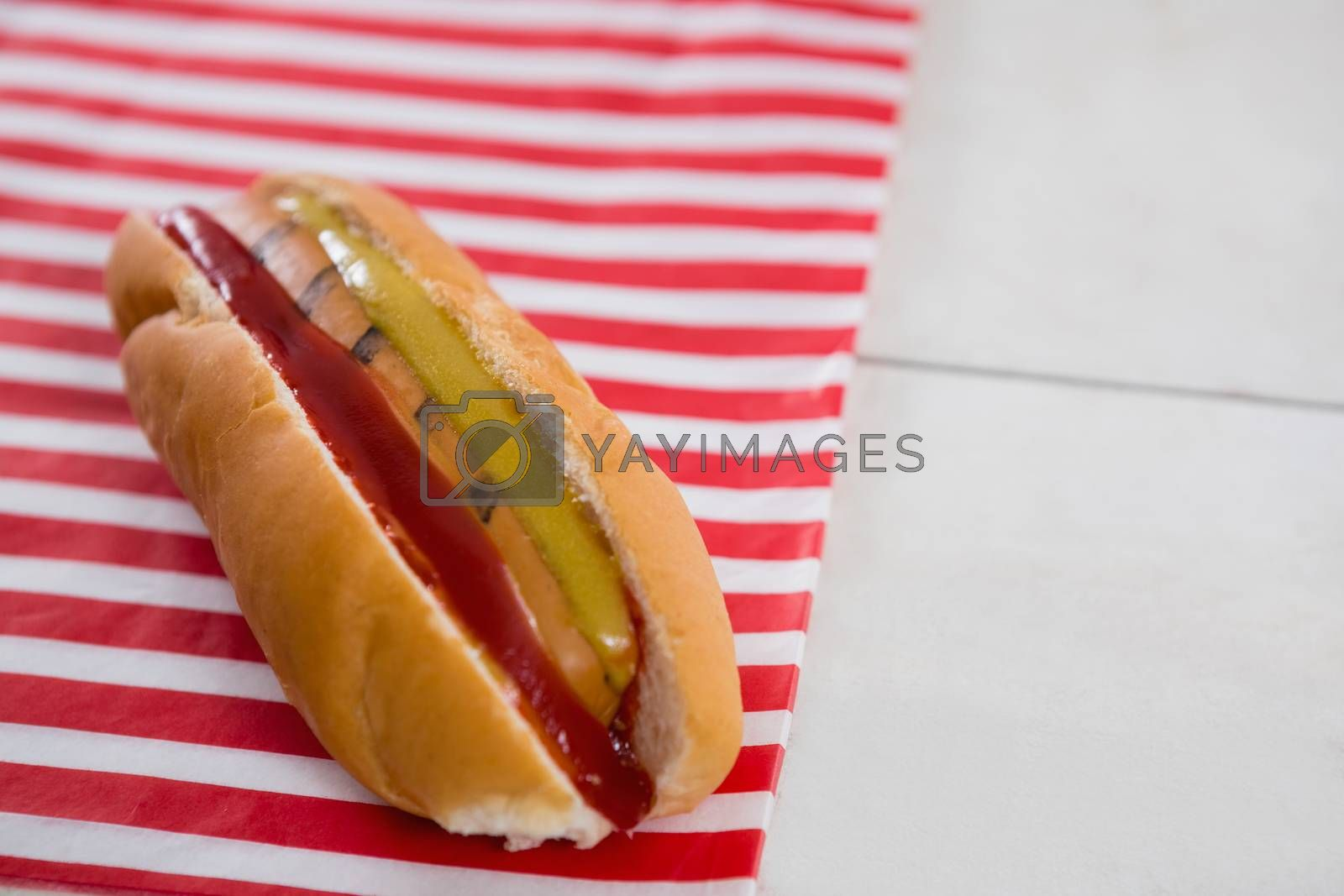 Close-up of Hot dog on wooden table with 4th july theme