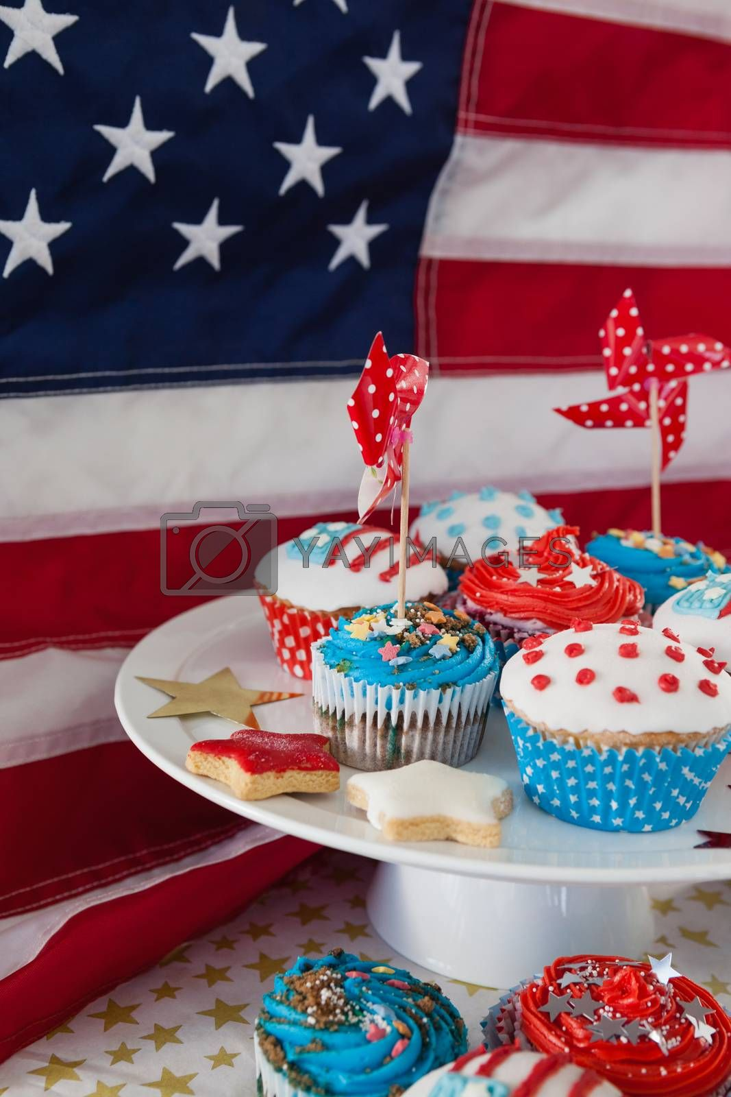 Decorated cupcakes with 4th july theme against American flag