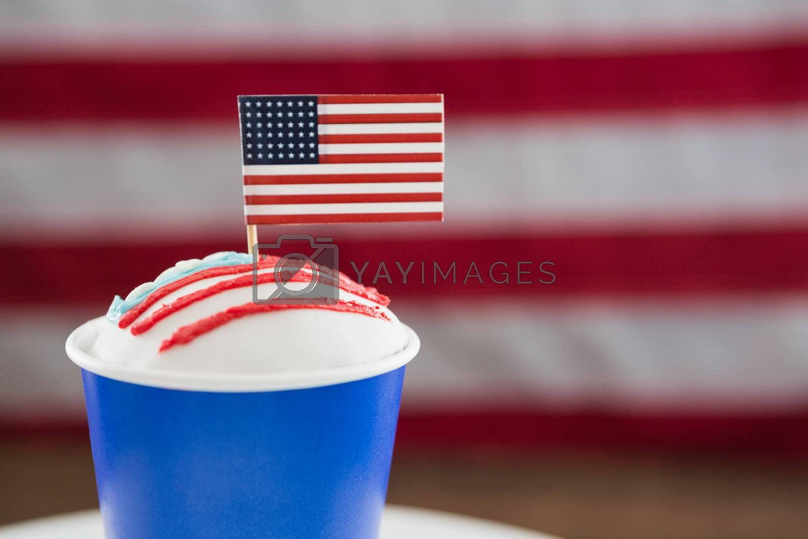 Close-up of patriotic coffee with American flag on wooden table