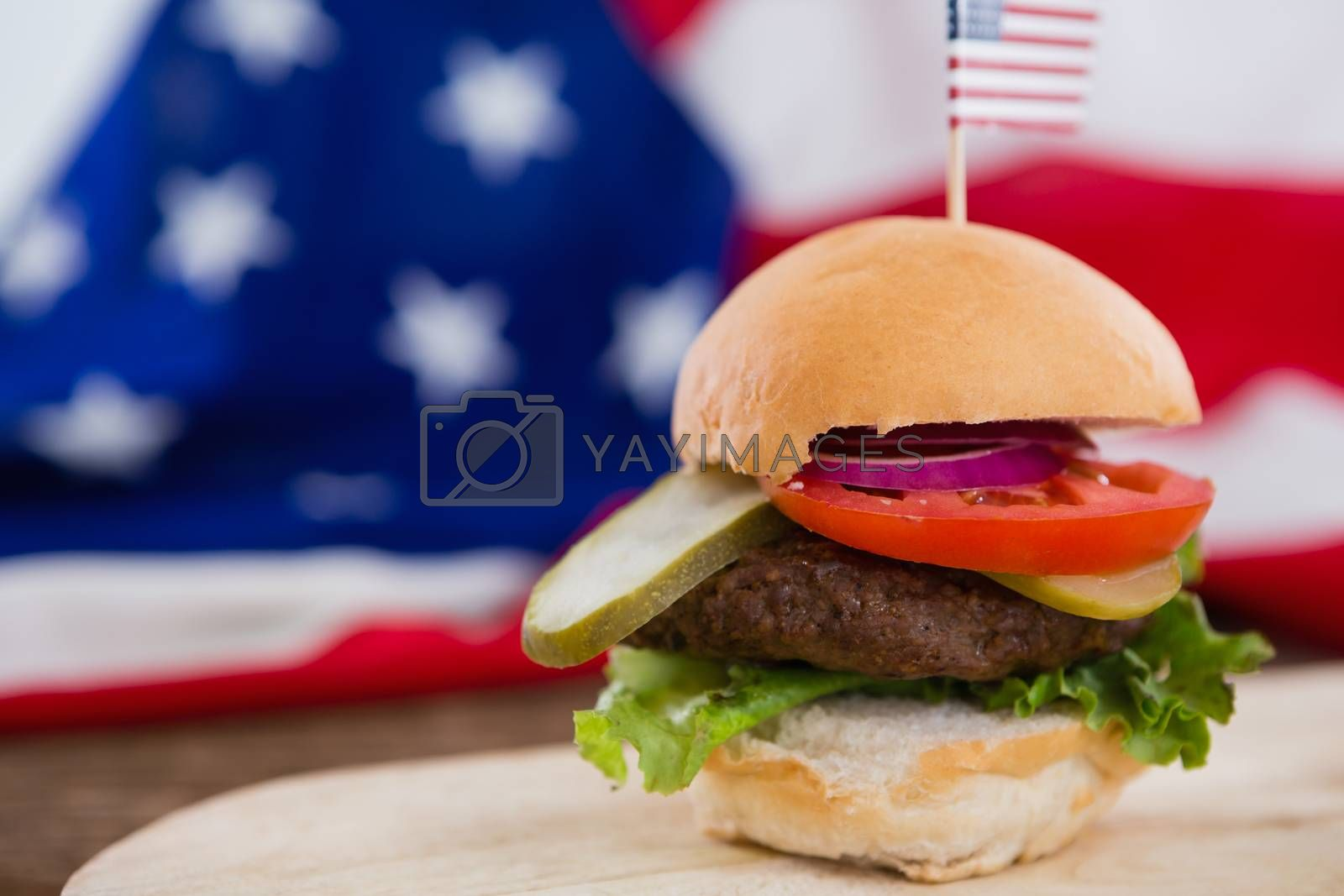 Close-up of burger on wooden table with 4th july theme