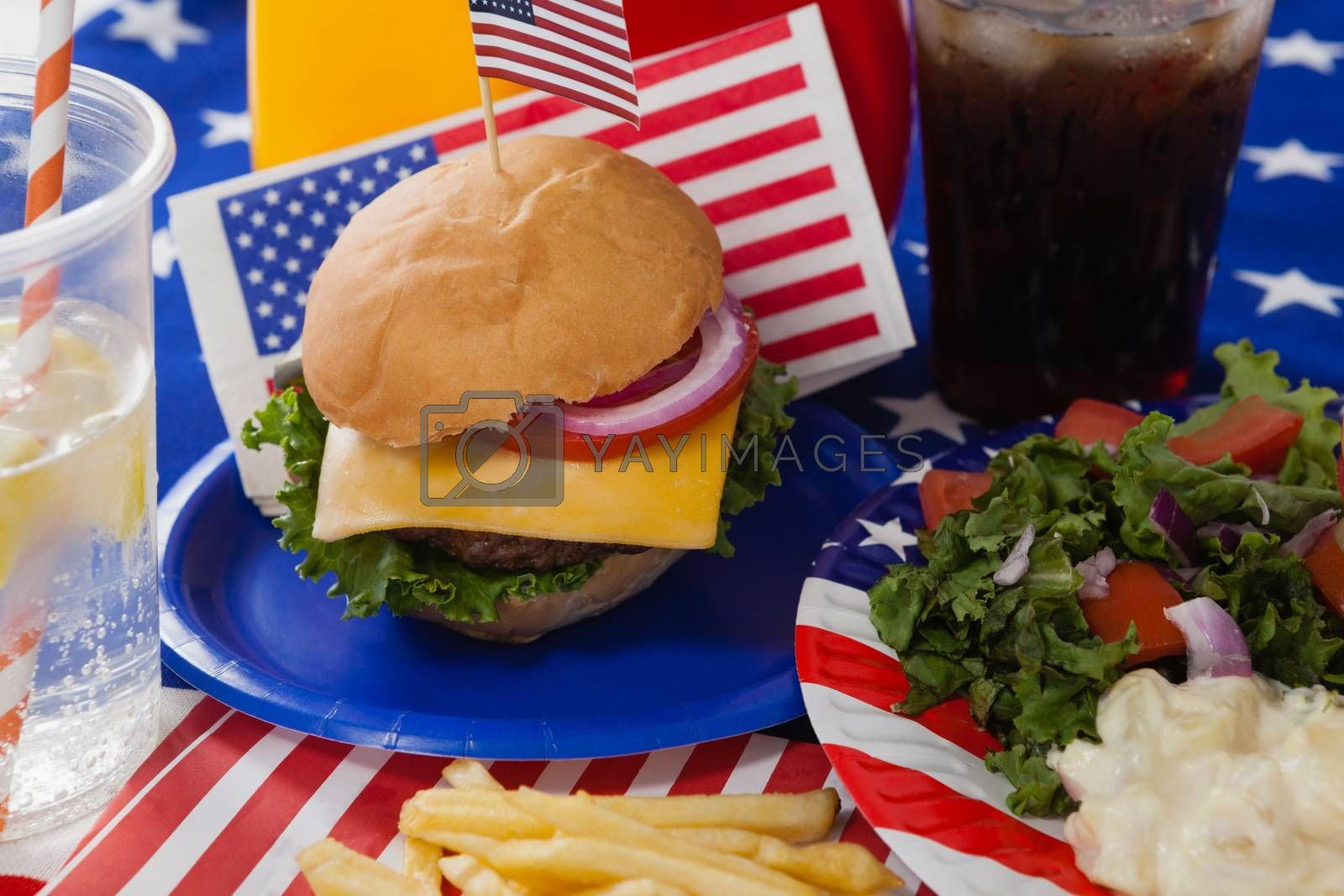 Close-up of drink and snacks decorated with 4th july theme