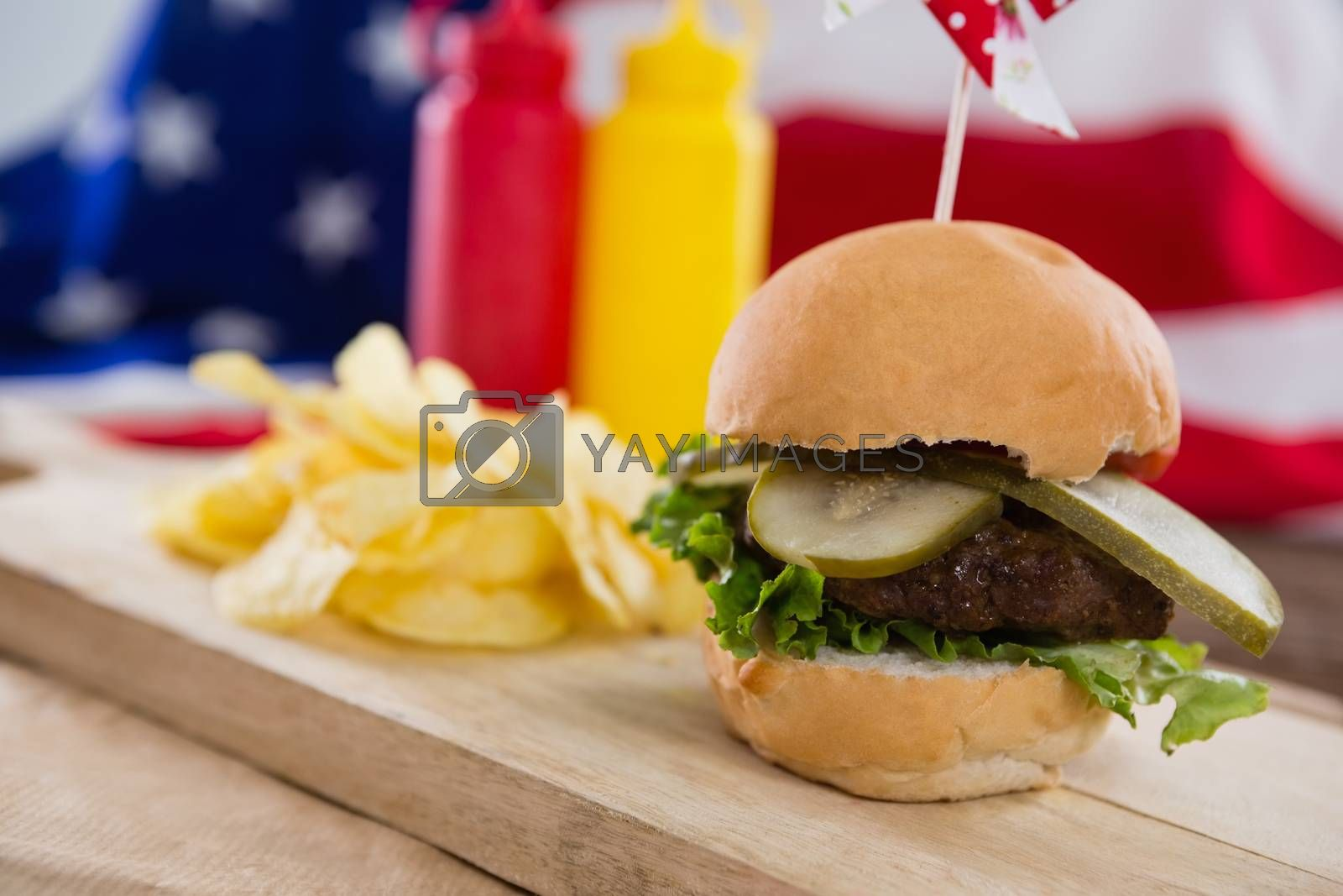 Close-up of burger on wooden board with 4th july theme