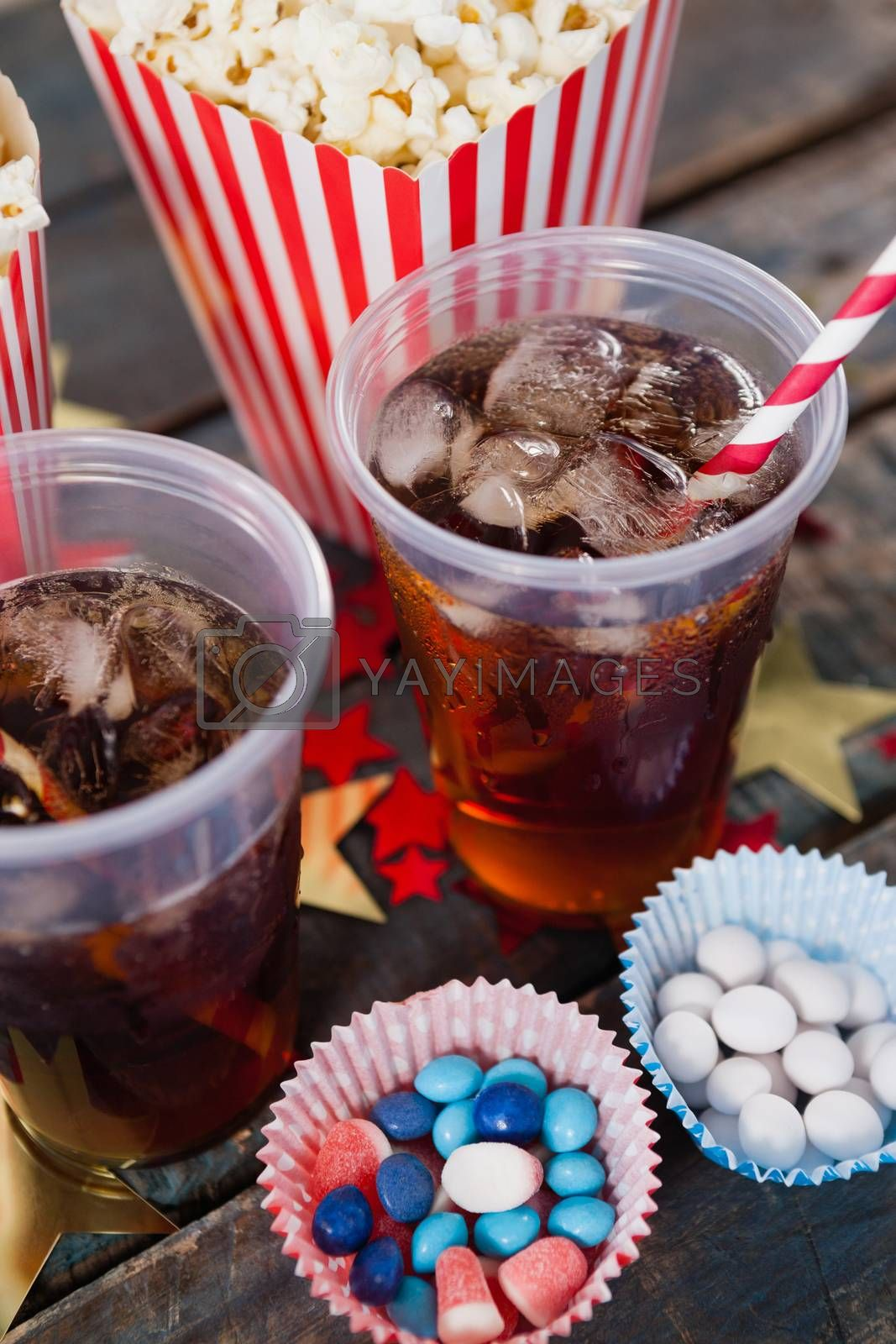 Popcorn, confectionery and drink with 4th july theme by Wavebreakmedia