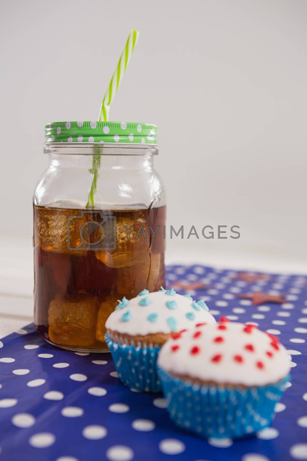 Close-up of drink and cupcake with 4th july theme by Wavebreakmedia