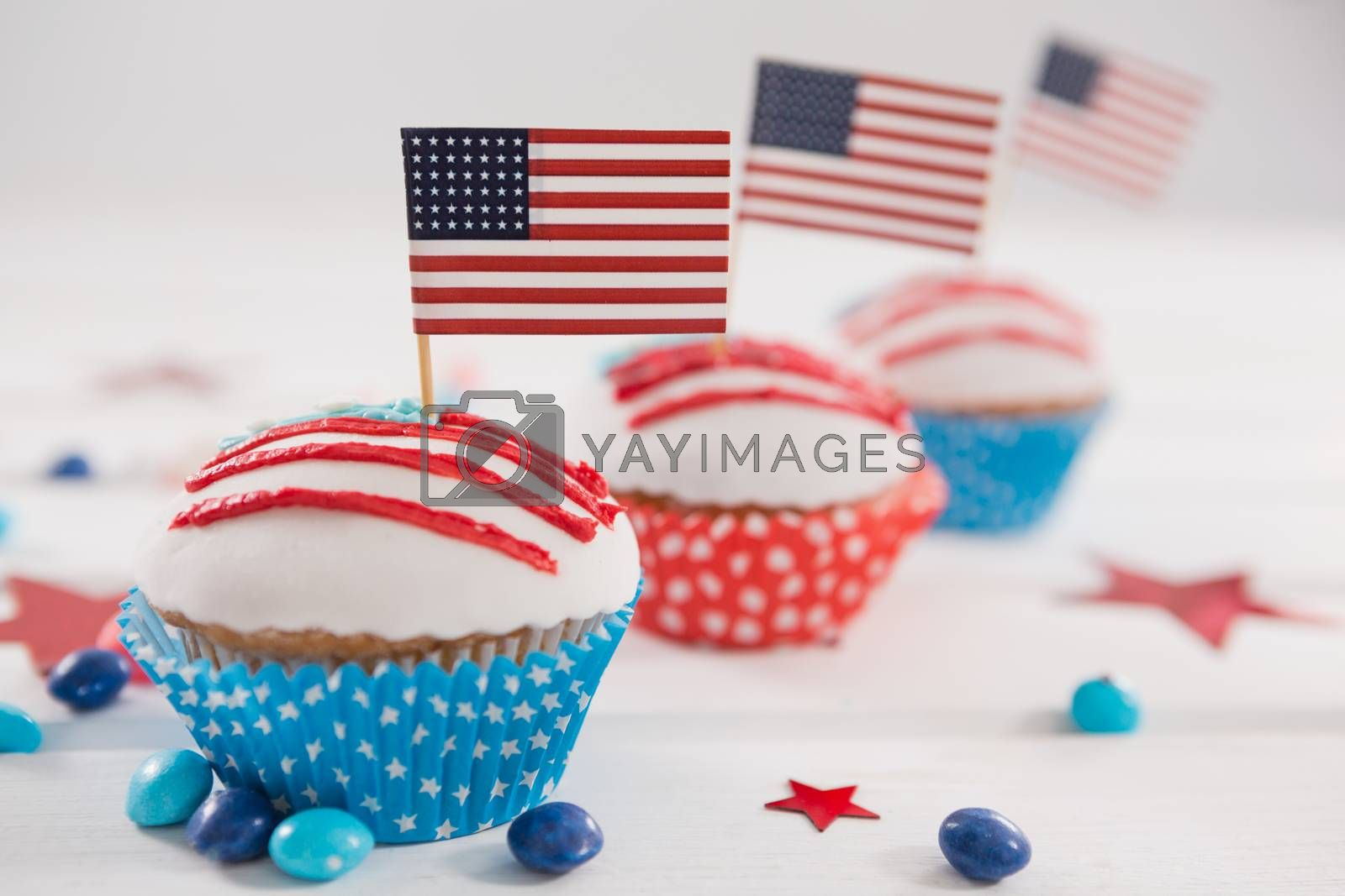 Close-up of cupcakes decorated with 4th july theme on wooden table