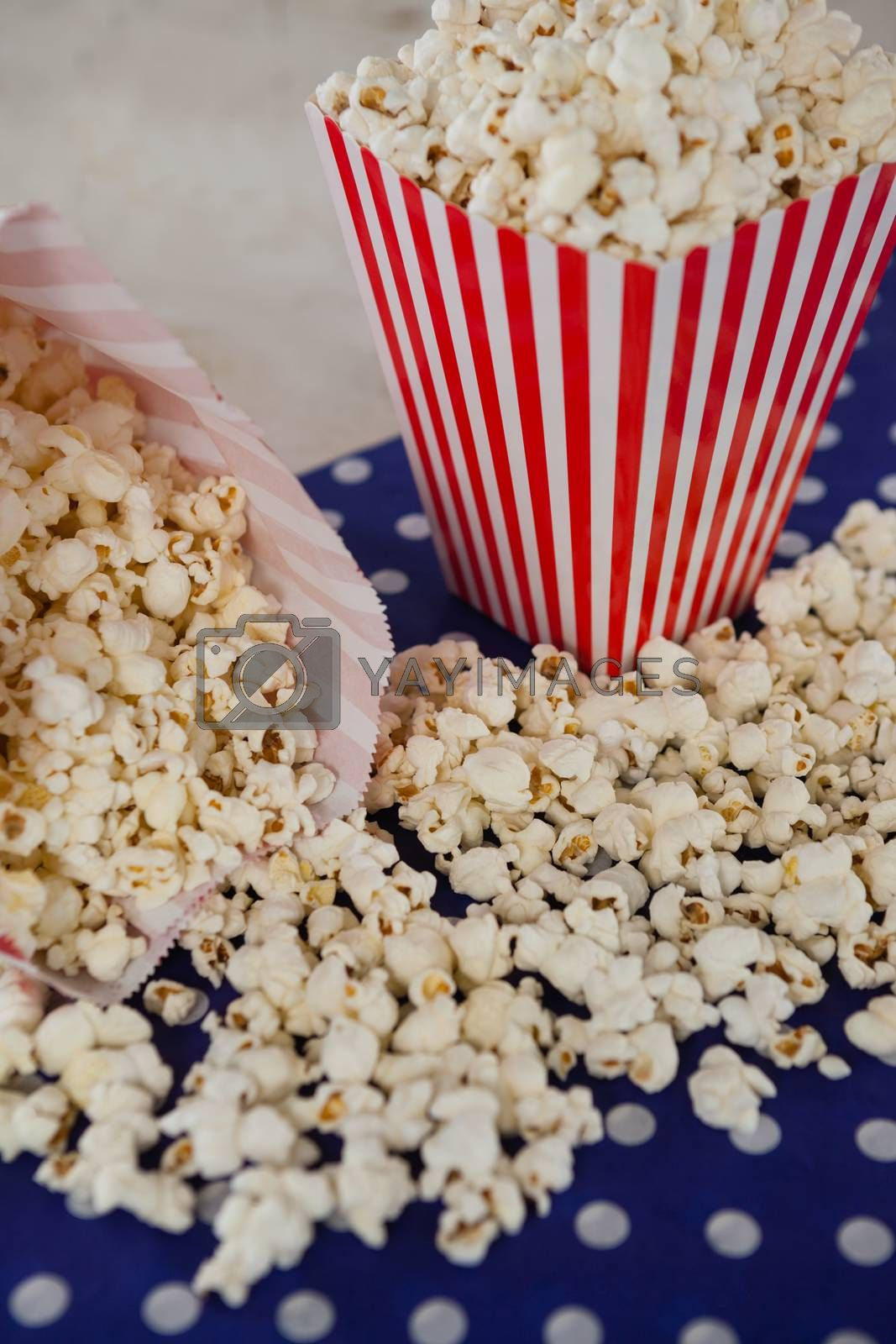 Close-up of popcorn with 4th july theme on wooden table