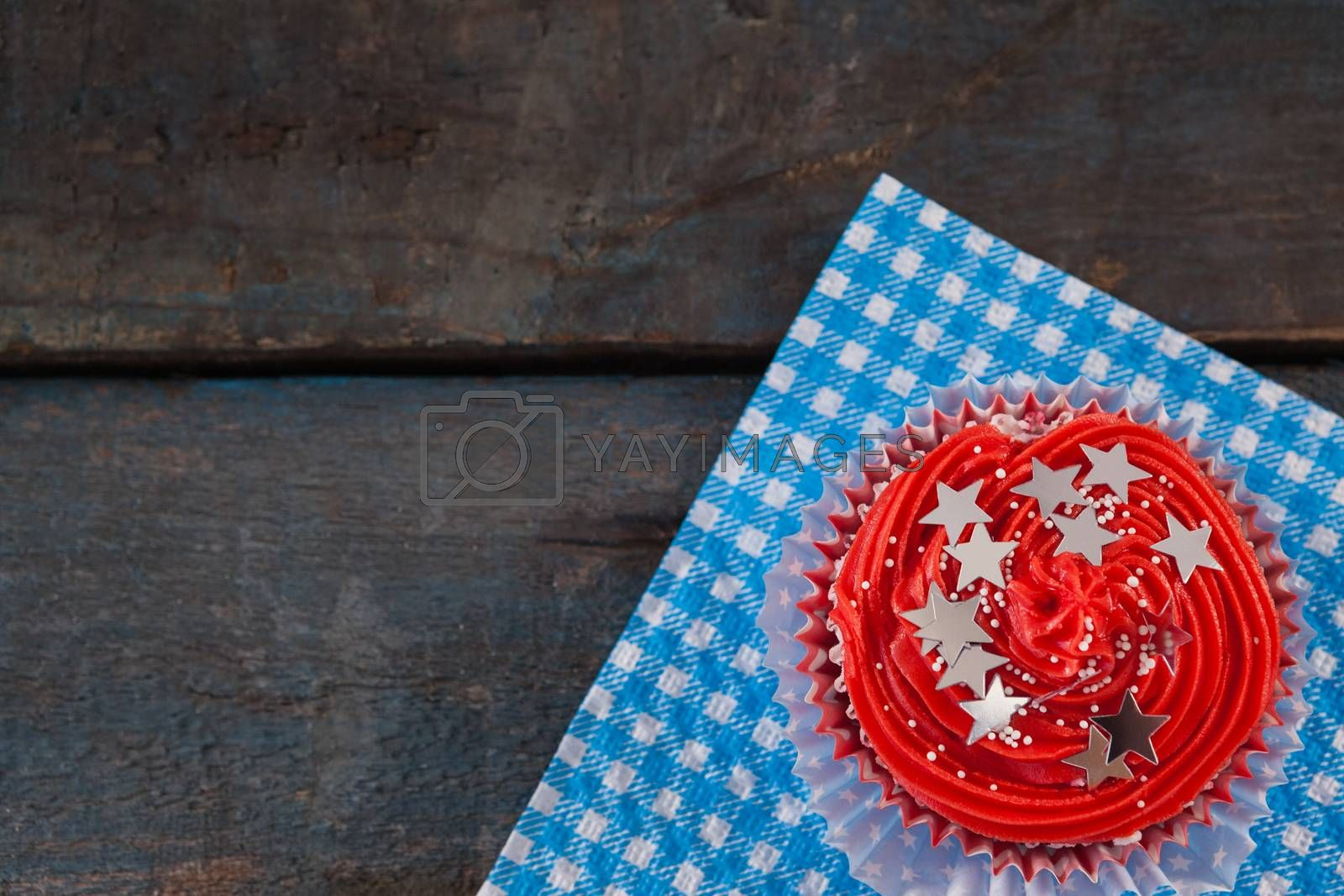 Decorated cupcake with 4th july theme on blue napkin