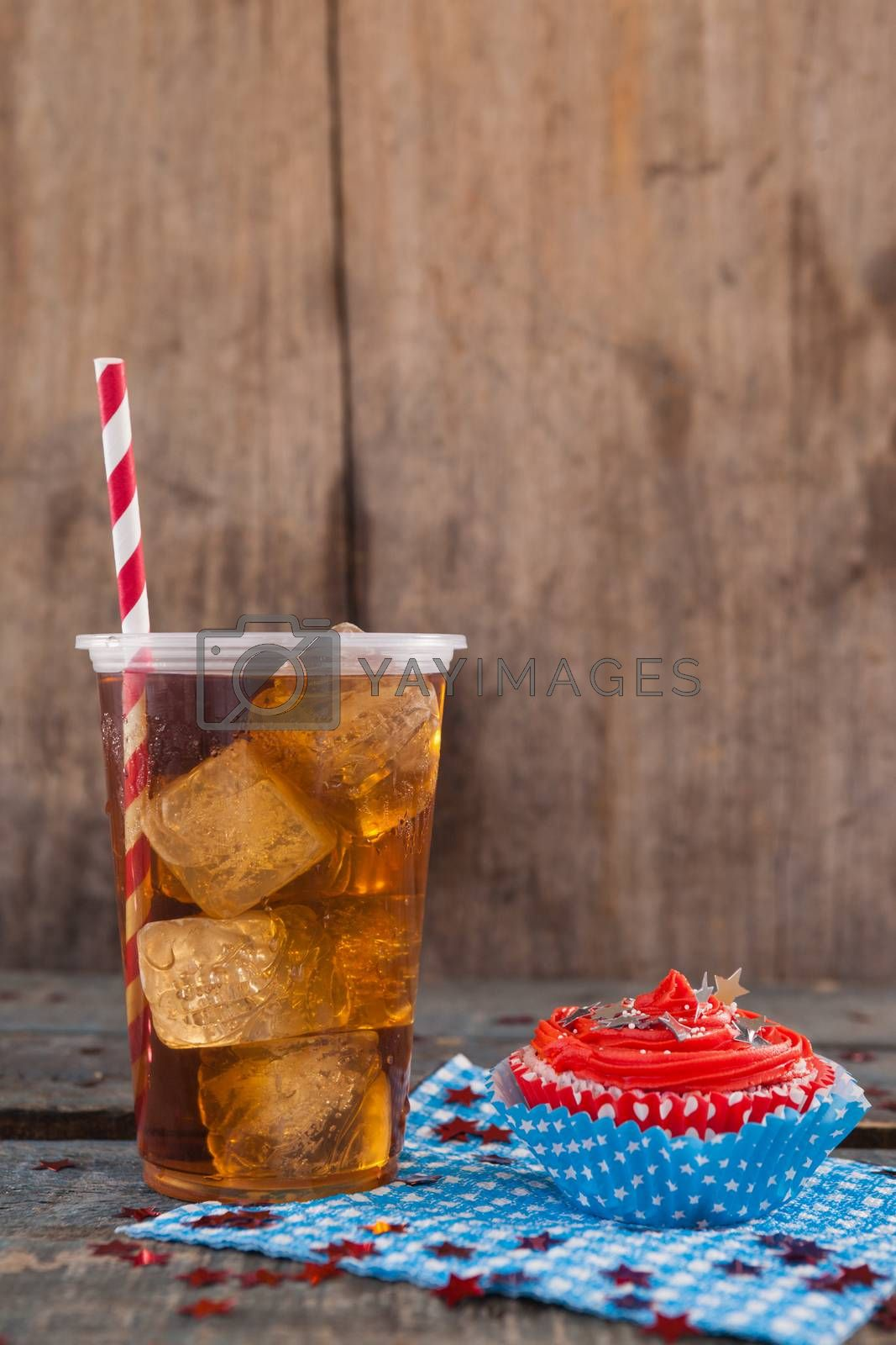 Decorated cupcake and cold drink with 4th july theme by Wavebreakmedia