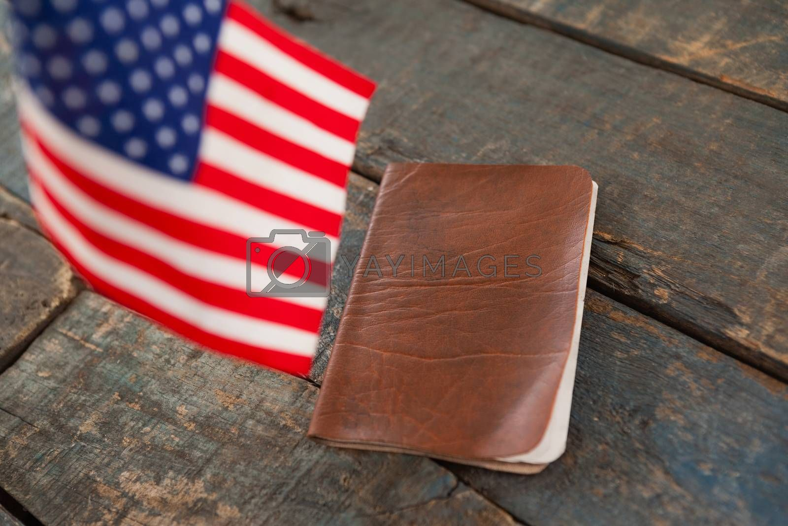 Close-up of visa and American flag on a wooden table