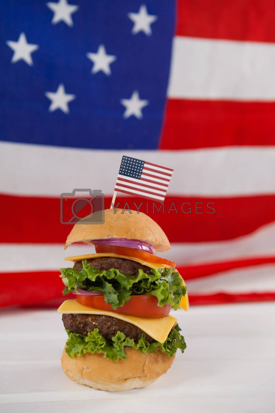 Hamburger with 4th july theme against American flag