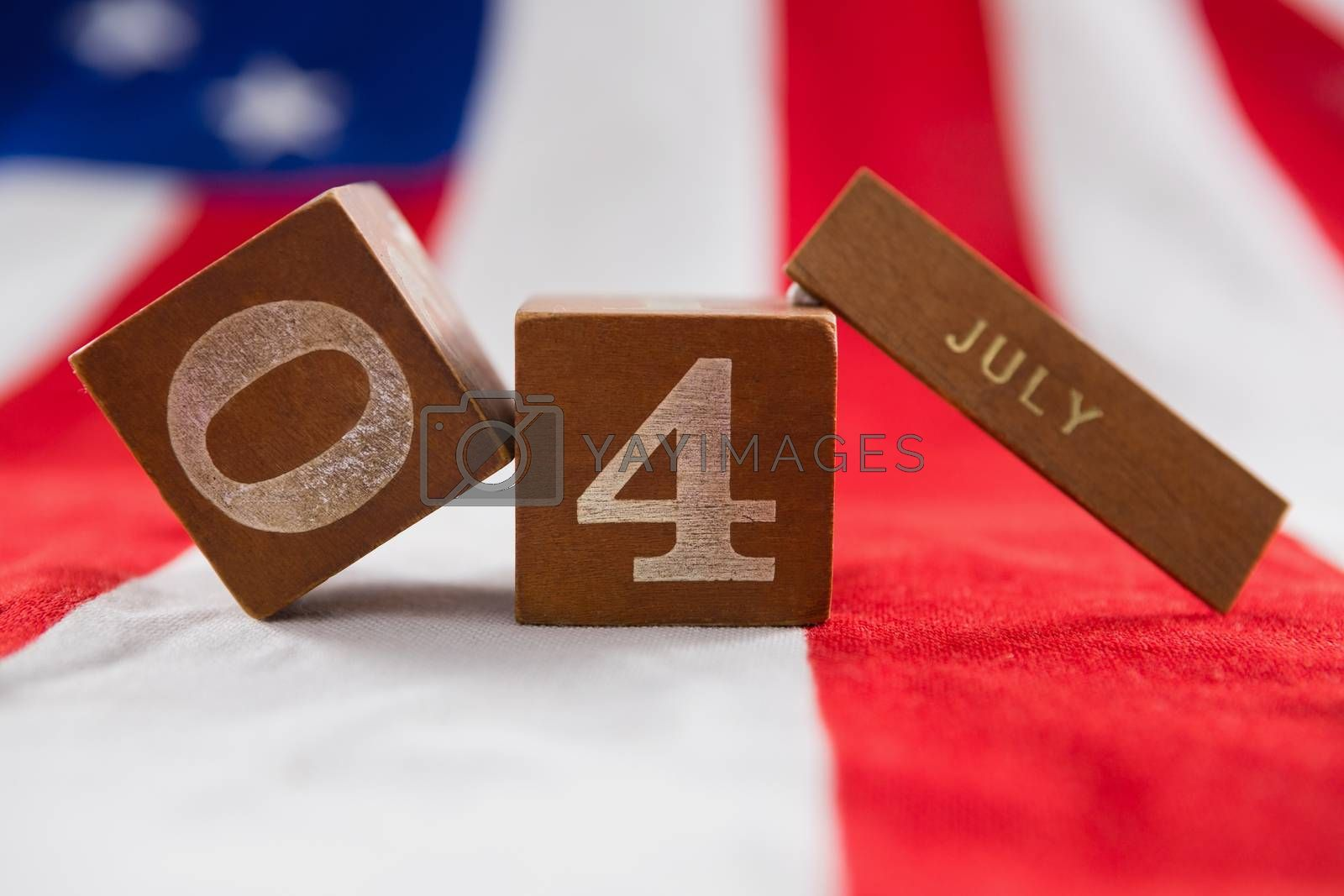 Close-up of date blocks on American flag with 4th july theme