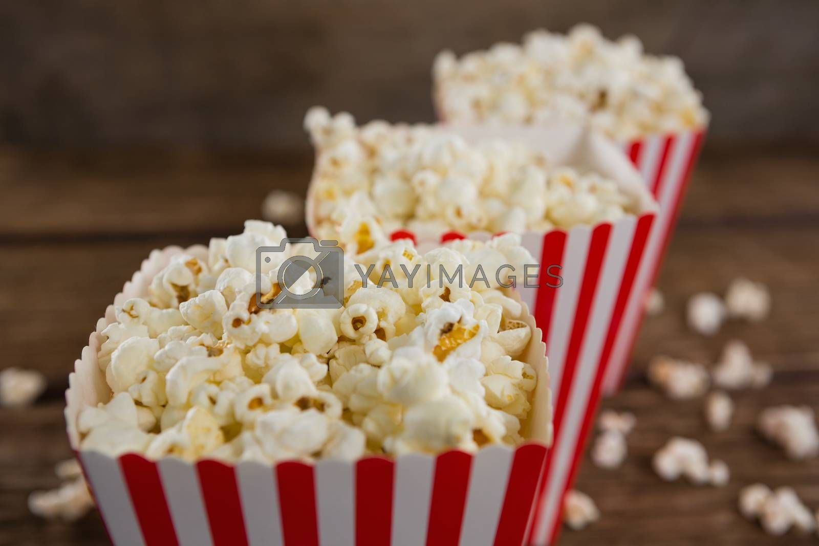 Popcorn arranged in a row with 4th july theme on wooden table