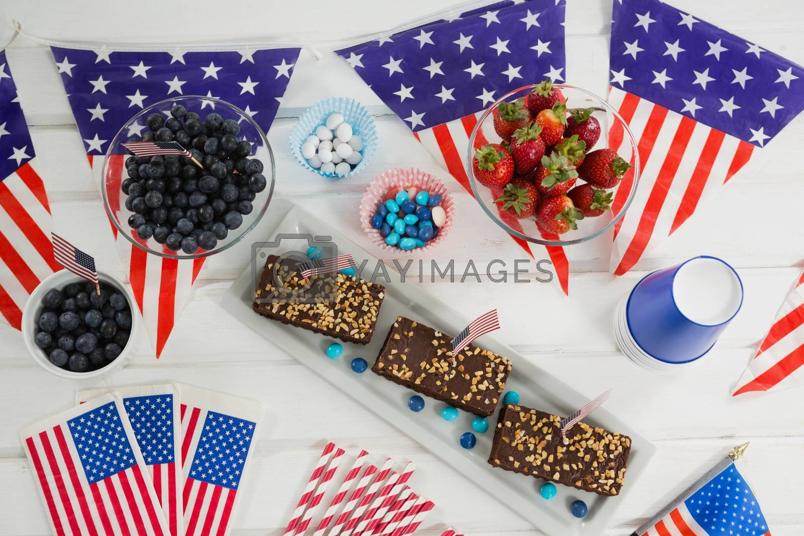 Sweet food decorated with 4th july theme on wooden table