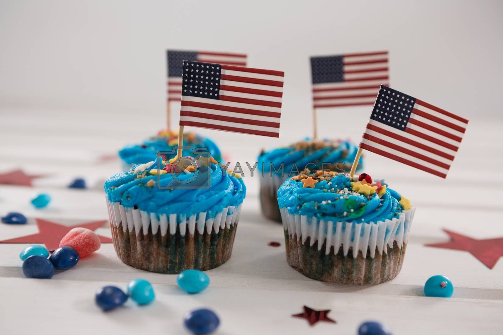 Cupcakes decorated with 4th july theme on wooden table