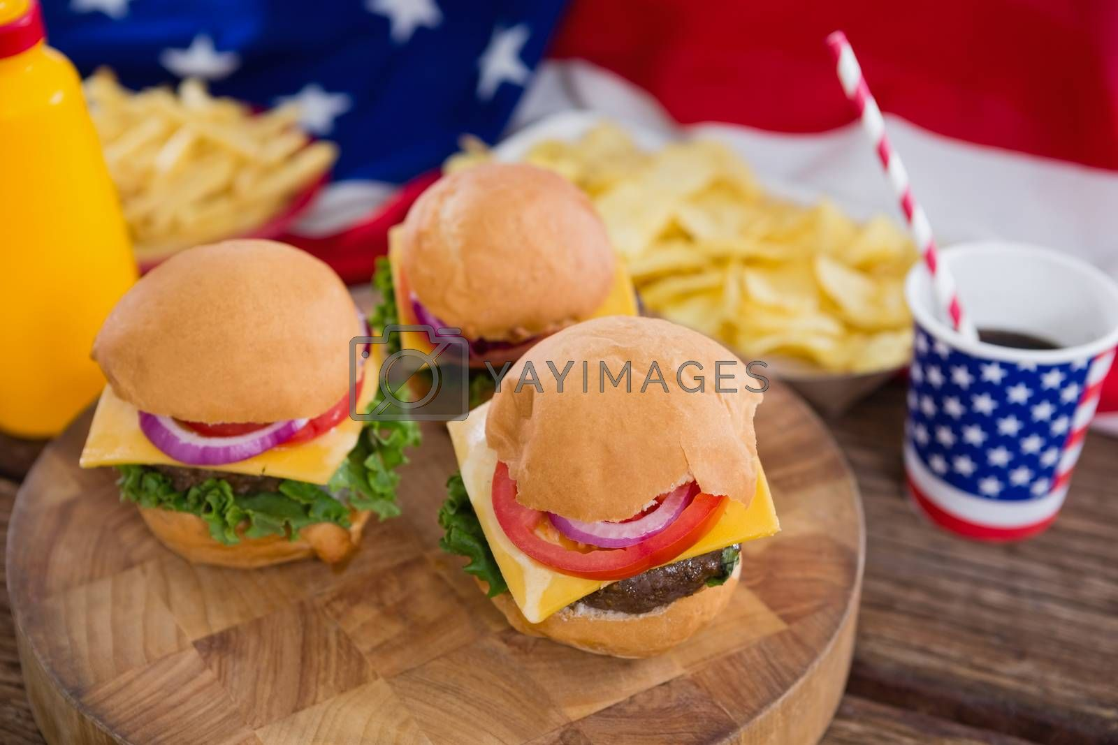 Close-up of burgers on wooden table with 4th july theme