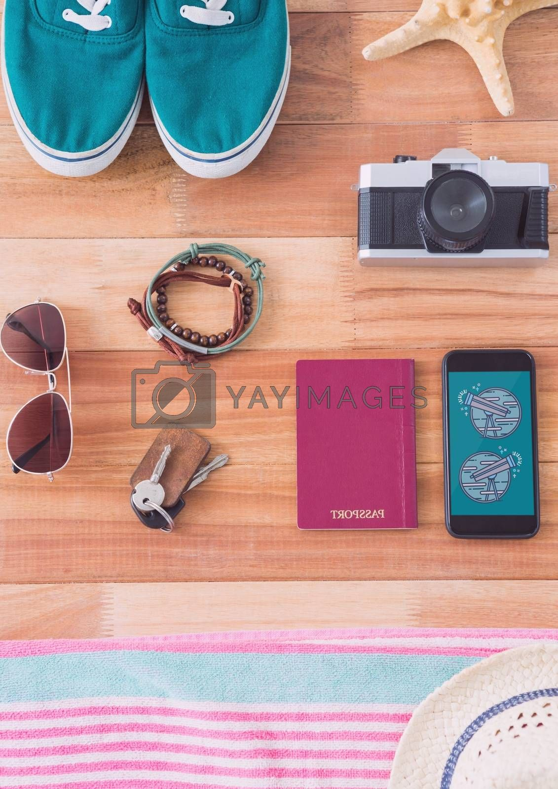 Phone with travel icons on the screen by Wavebreakmedia