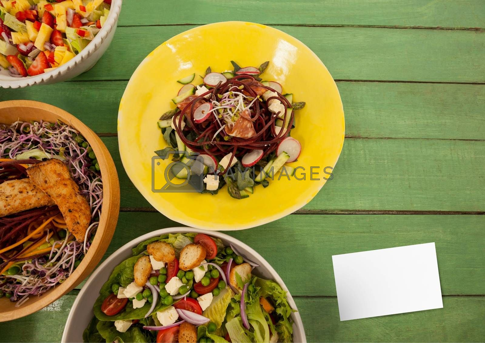 Digital composite of Bussiness card on green wooden desk with food