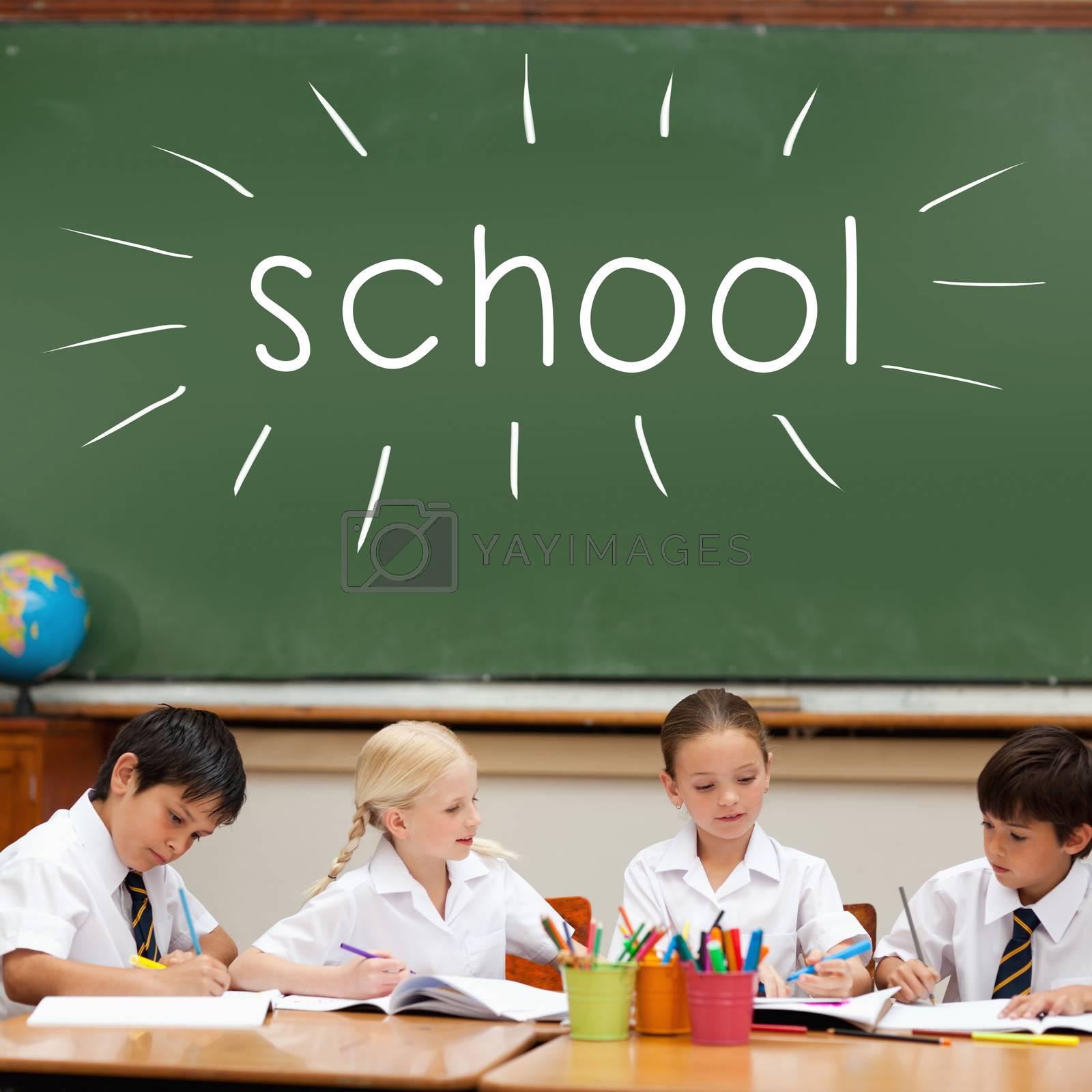 School against cute pupils sitting at desk by Wavebreakmedia