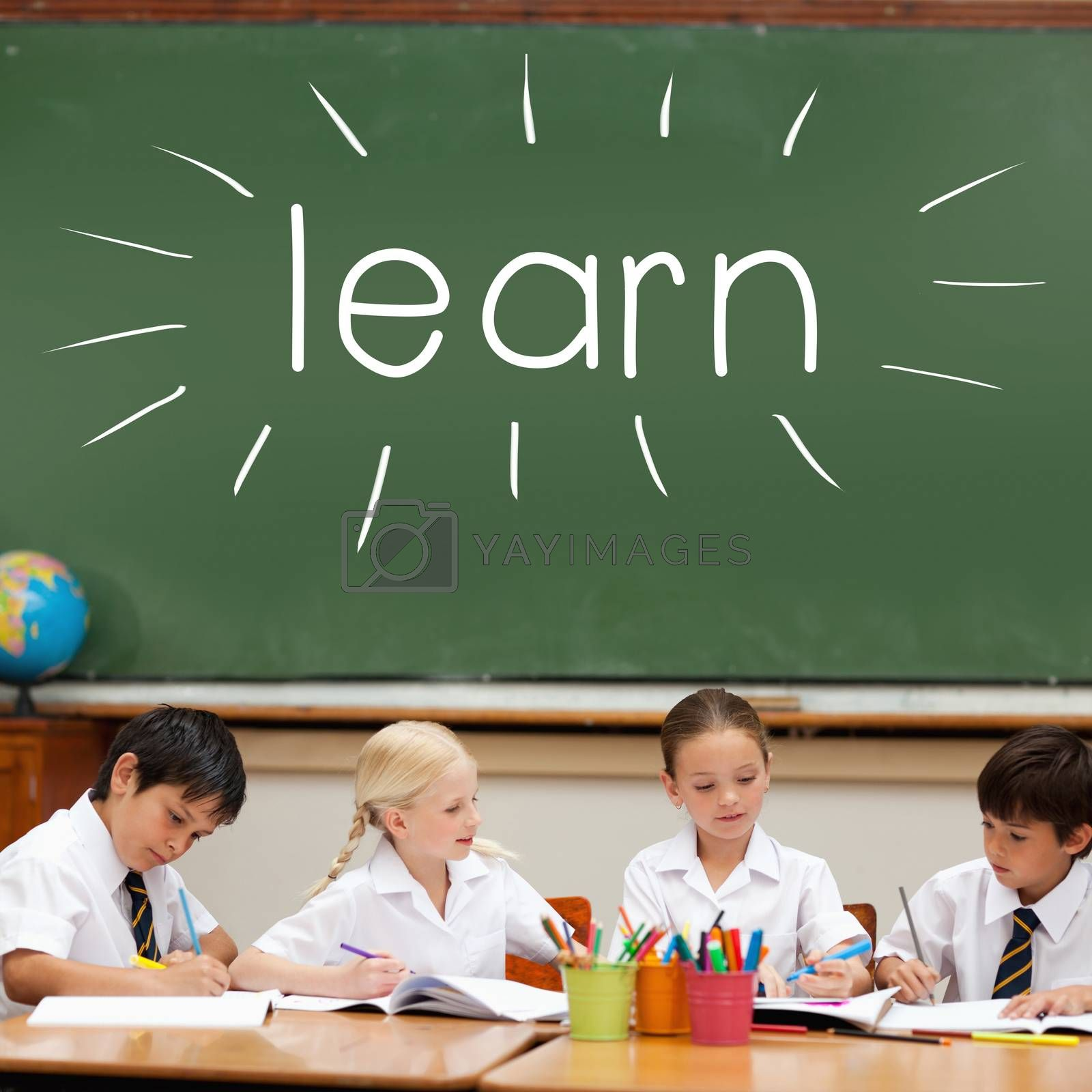 Learn against cute pupils sitting at desk by Wavebreakmedia