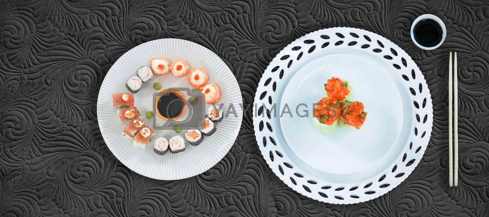 Close up of food in plate by chopstick against black background