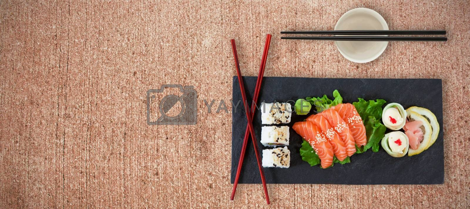 Close up of japanese food with chopsticks against weathered surface