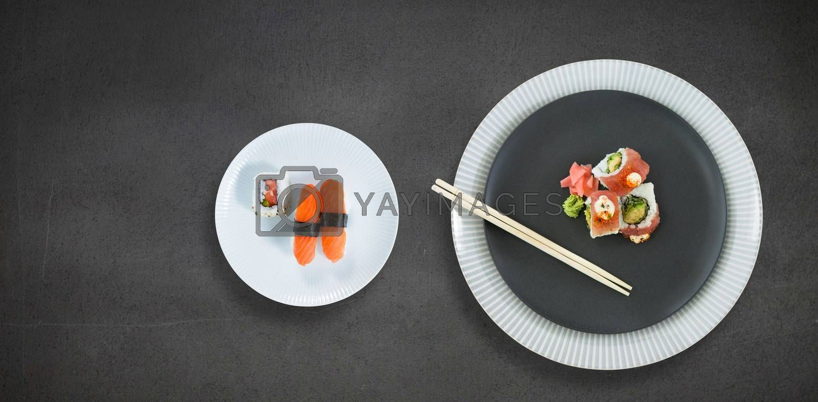 Close up of food with chopstick in plate against black wall