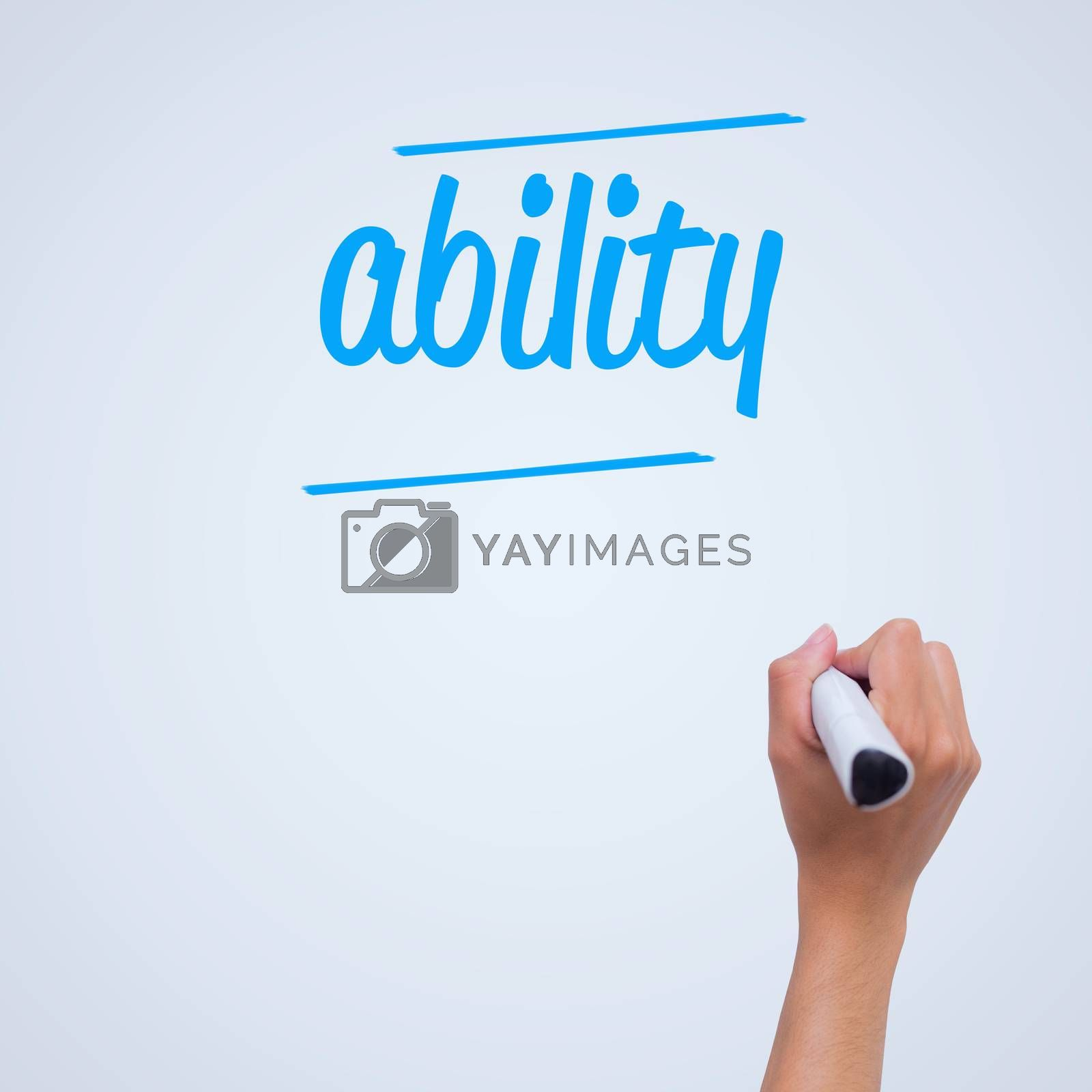 The word ability against female hand writing with marker