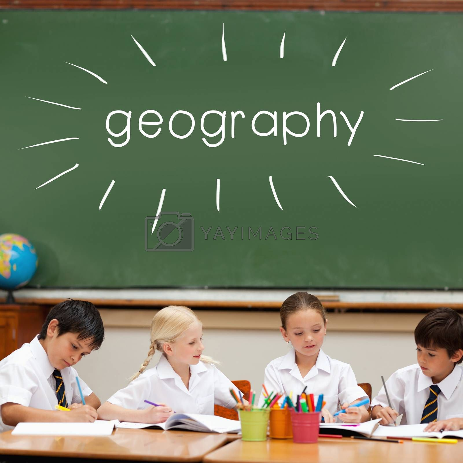 Geography against cute pupils sitting at desk by Wavebreakmedia