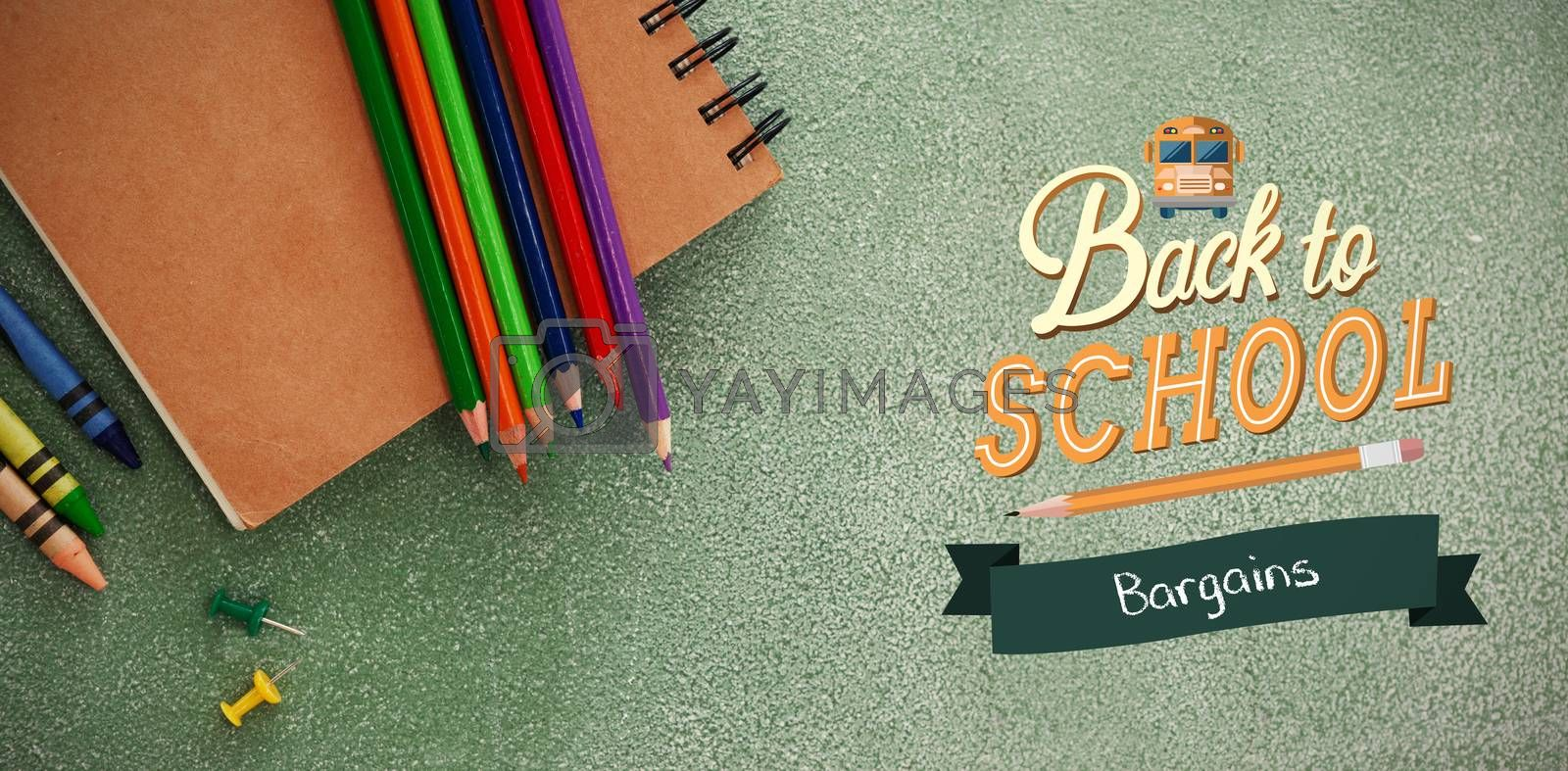 back to school against high angle view of colored pencils with book