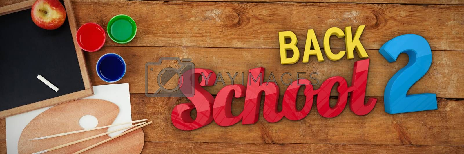 Back to school against palette with chalkboard on table