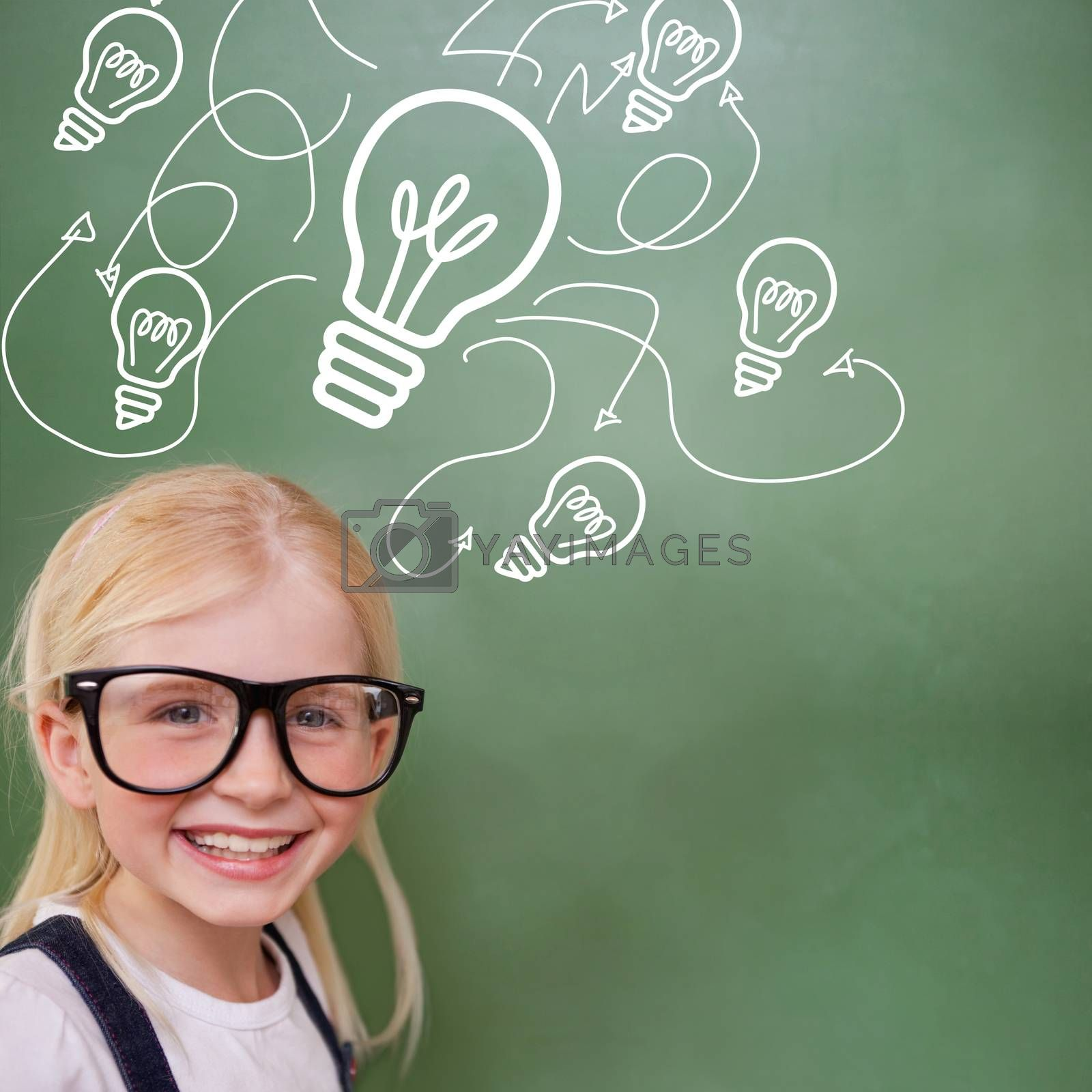 Cute pupil smiling against idea and innovation graphic