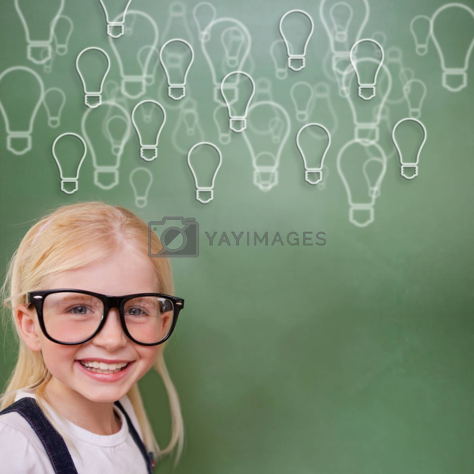 Cute pupil smiling against light bulbs