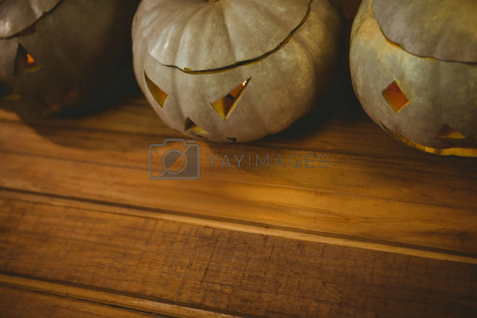 High angle view of jack o lanterns arranged on table during Halloween
