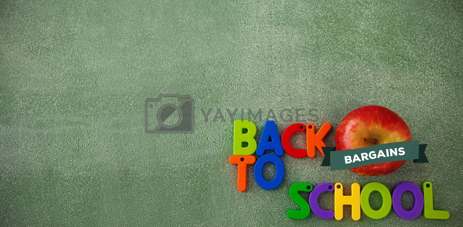 back to school against colorful back to school text blocks with apple