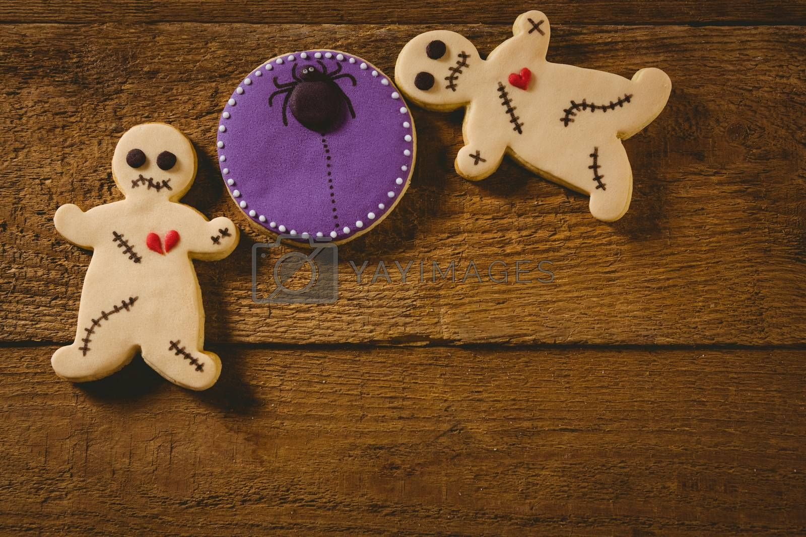Overhead view of Halloween cookies on wooden table