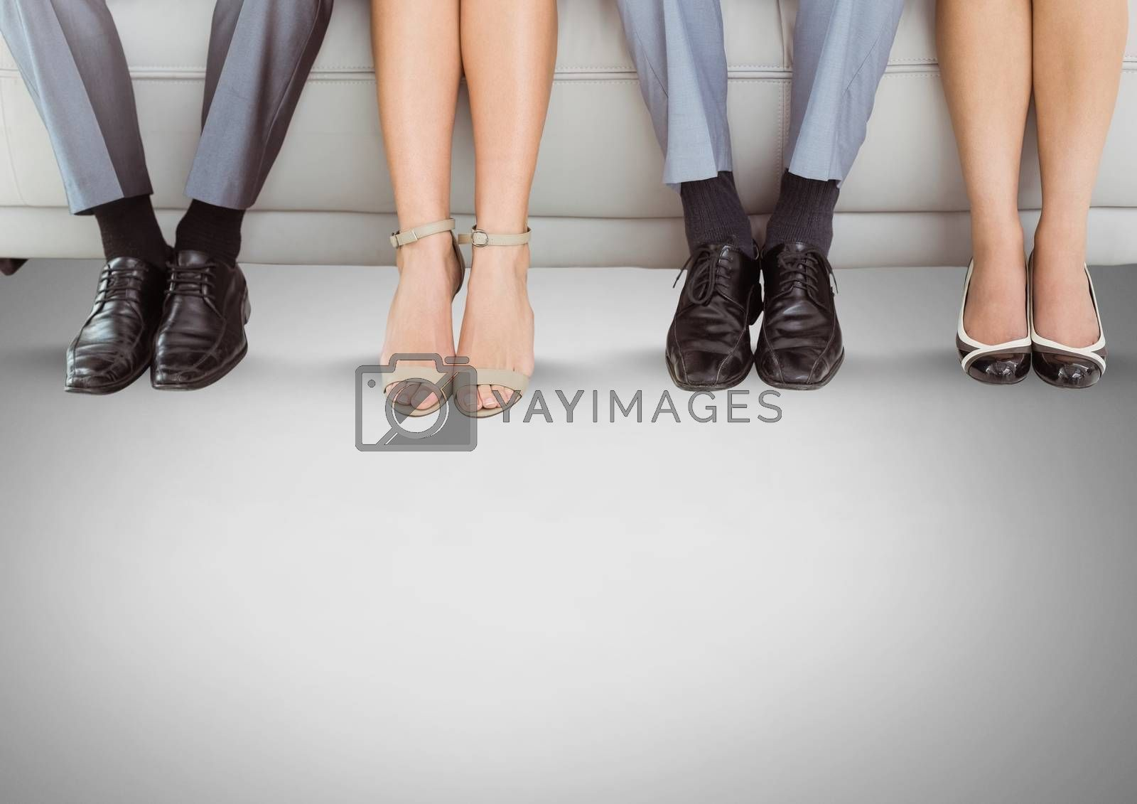 Digital composite of People legs and feet on couch
