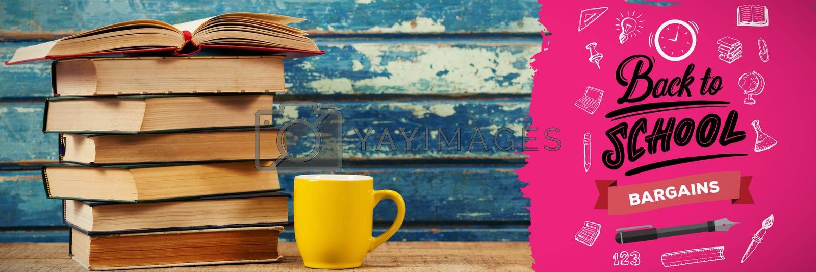 back to school against stack of books with cup on table