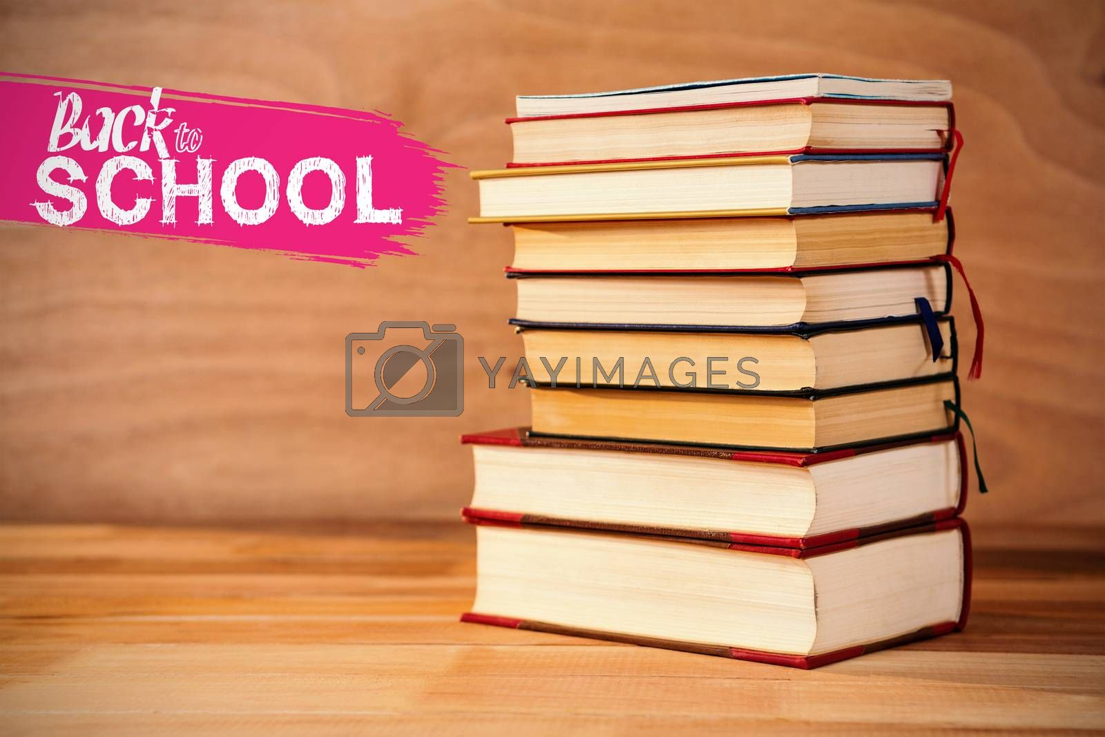 back to school against hardcover books stack on table