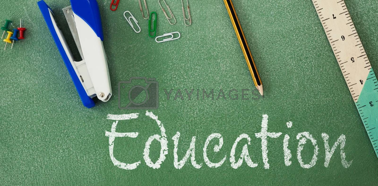Education text against white background against high angle view of stapler and ruler on table