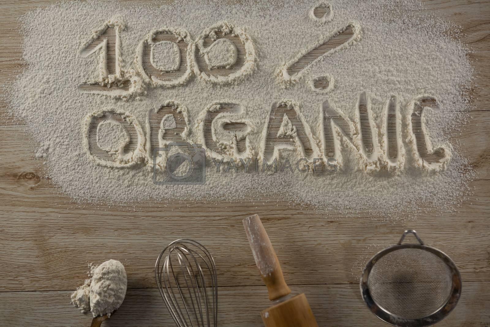 The word 100 percent organic written on sprinkled flour by Wavebreakmedia