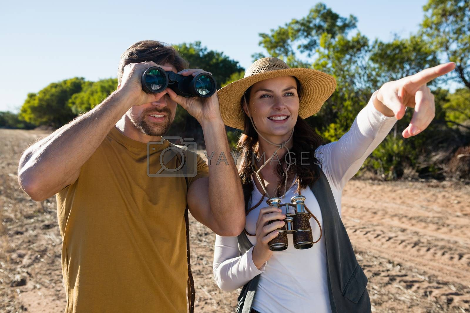Couple with binoculars at forest by Wavebreakmedia