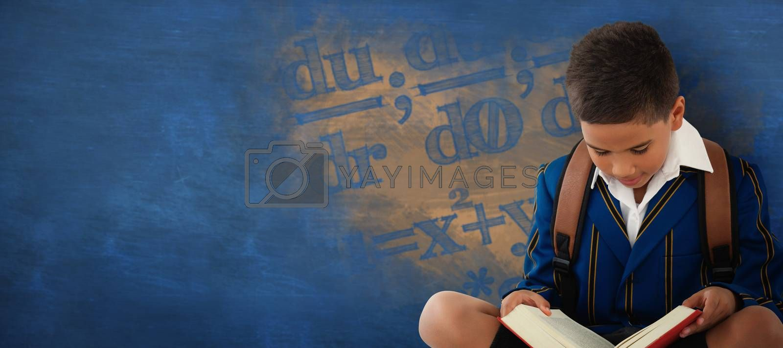 Composite image of schoolboy reading book over white background by Wavebreakmedia