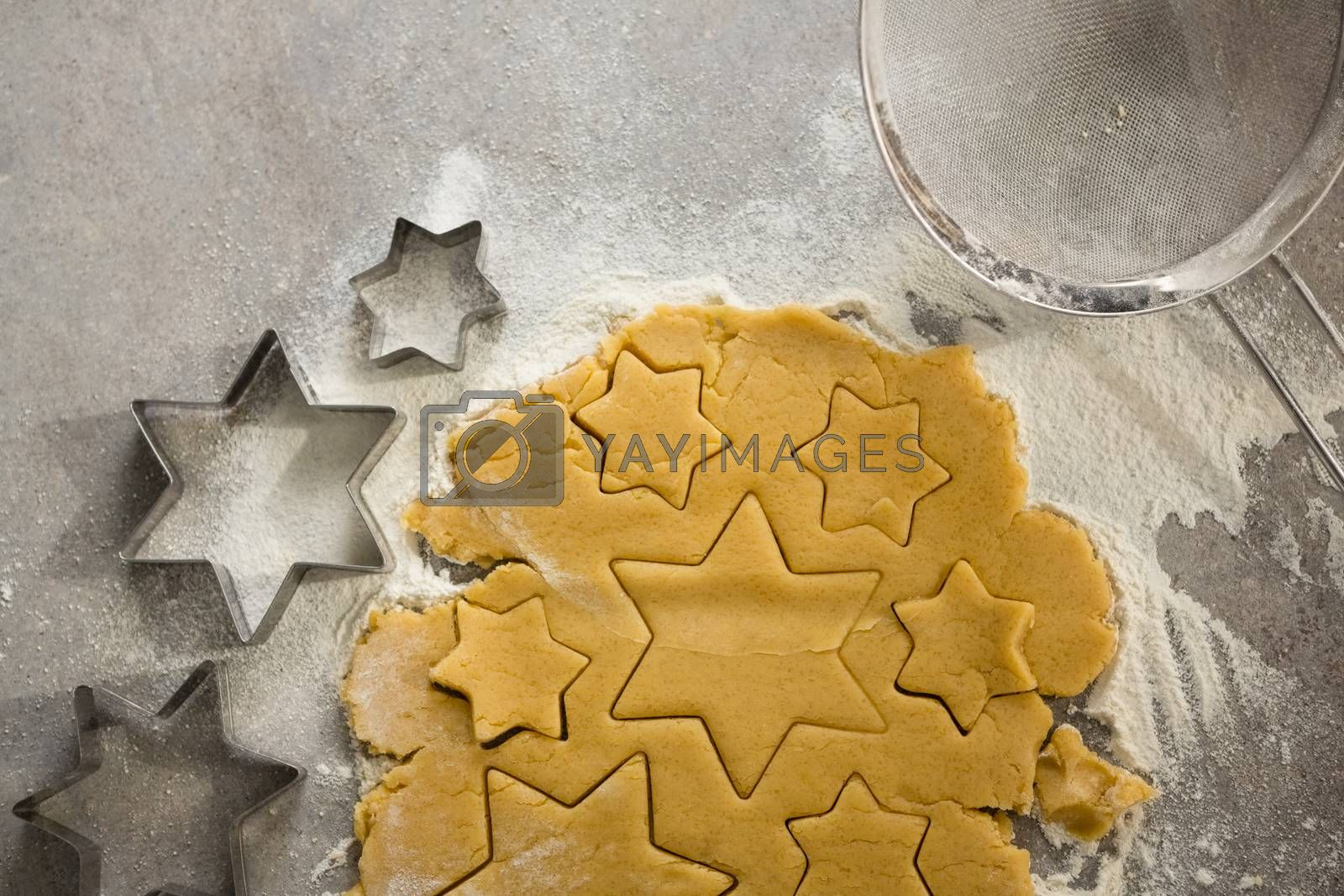 Raw cookie dough with star shape and cutter by Wavebreakmedia
