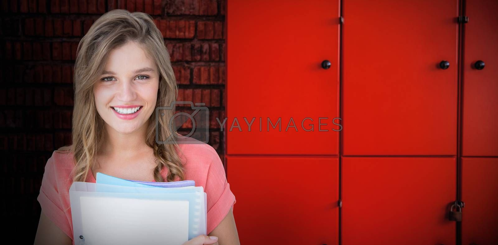 Composite image of smiling hipster holding notebook  by Wavebreakmedia