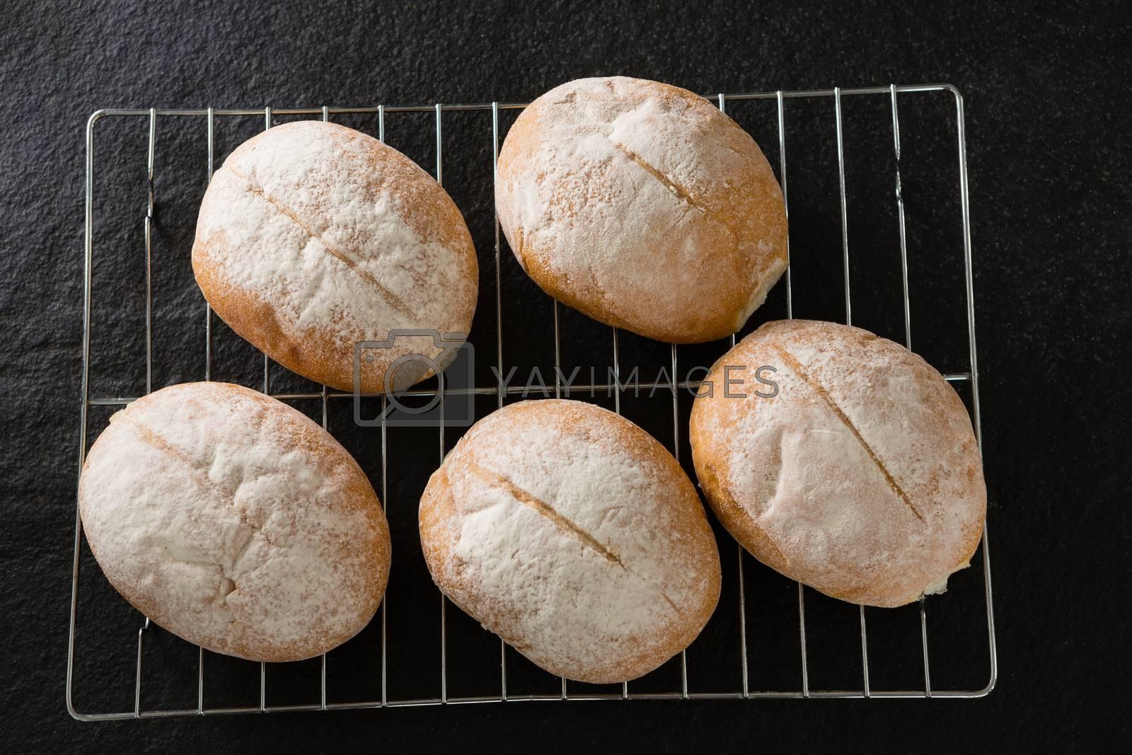Dough balls with icing sugar on baking tray by Wavebreakmedia