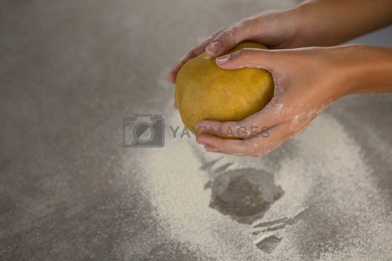 Woman holding a dough by Wavebreakmedia