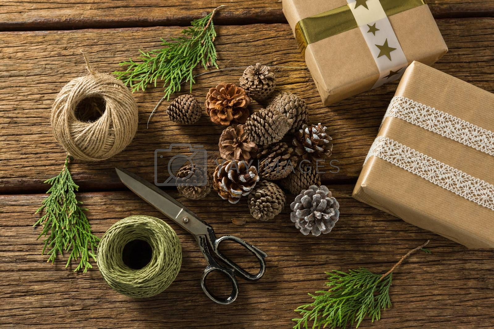 Overhead view of pine cones with gift boxes and thread spools by Wavebreakmedia