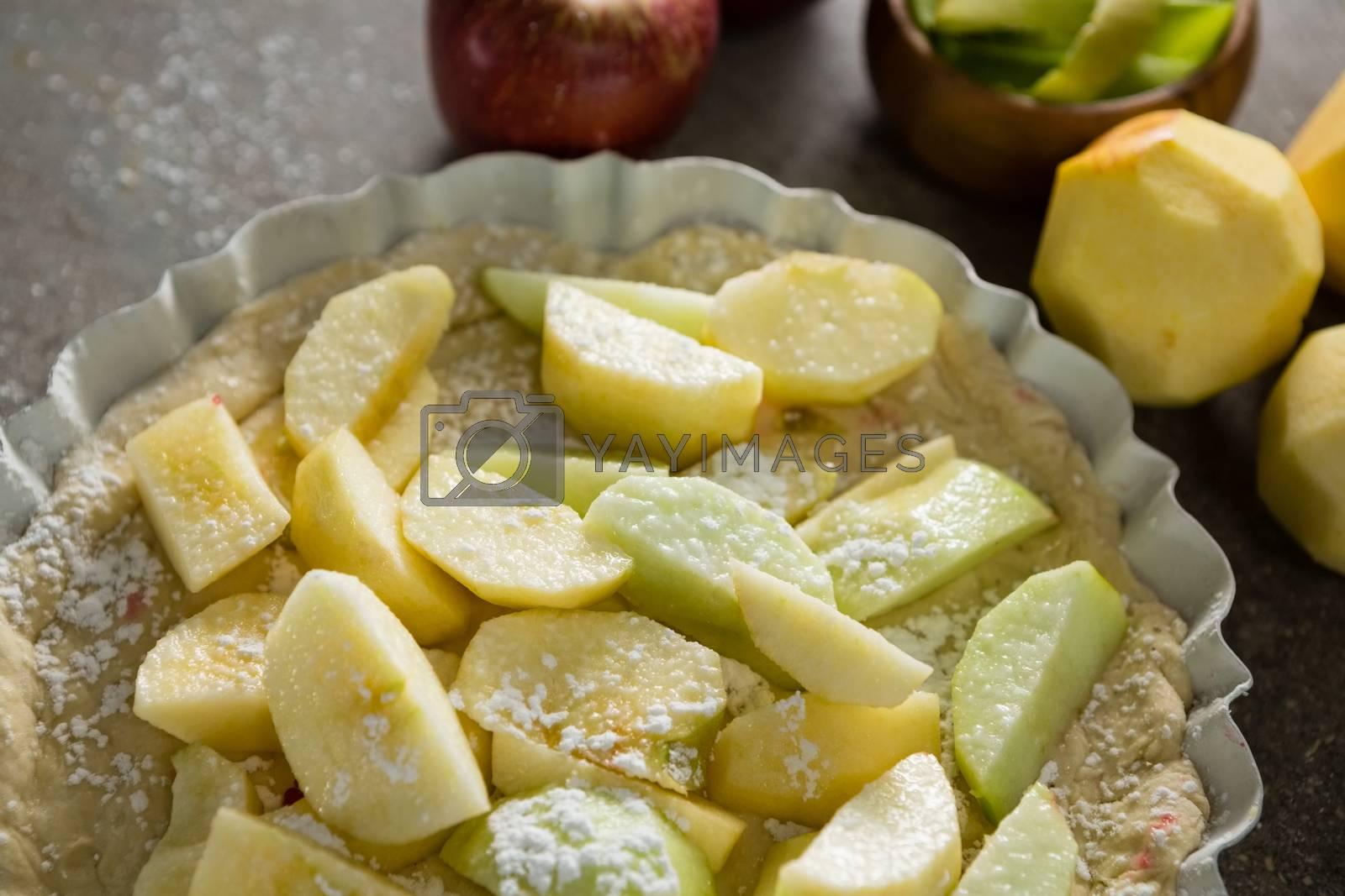 Slice of apple on tart with icing sugar by Wavebreakmedia