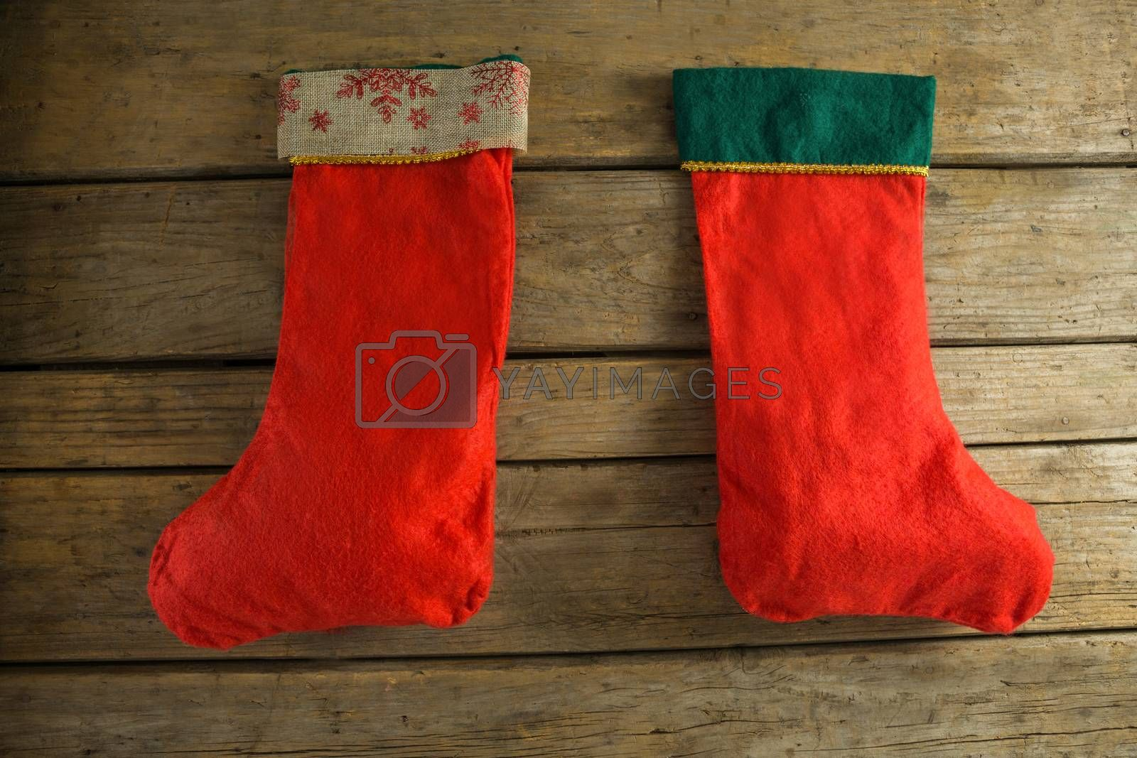 Christmas stocking on wooden wall by Wavebreakmedia
